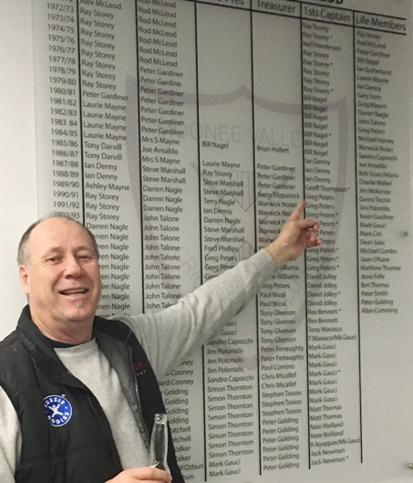 Ian Denny points to some of the illustrious names on the new Moonee Valley Cricket Club honor board.