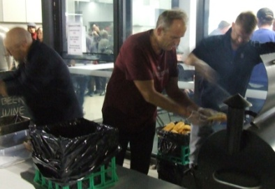 Cricket Premiership players get to work on feeding the masses: L-R Paul Hobbs, Brett Curran and Dean Lawson.