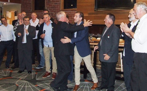 Welcome to our select group: Sean O'Kane receives a hug from fellow Life Member Jim Polonidis (right)