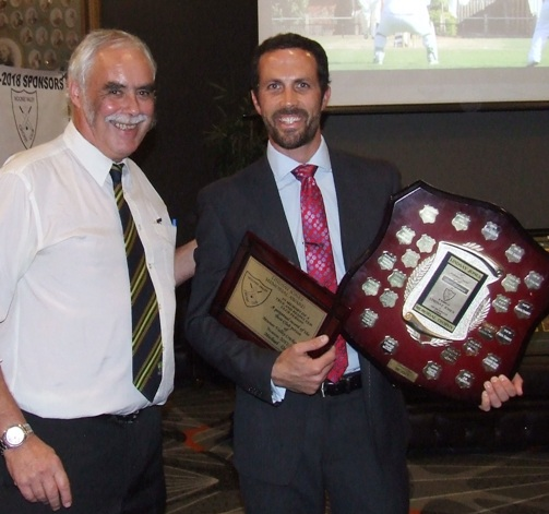 Great clubman Michael Ozbun (right) receives his Lindsay Jones award from President Charlie Walker.