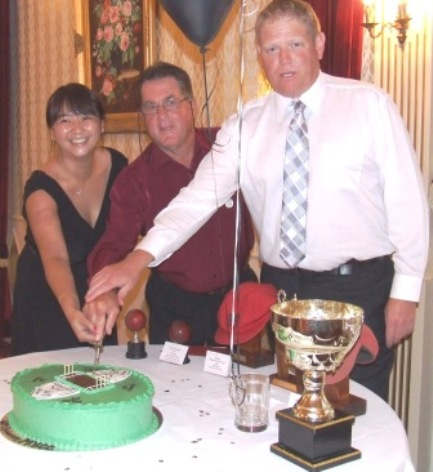 *Cutting the cake: L-R Tien Polonidis, who designed it; MVCC founder Ray Storey, and our first 300 gamer, Darren Nagle.